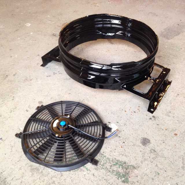 Freshly painted fanshroud and the new electric cooling fan ready to install in the Impala tonight...